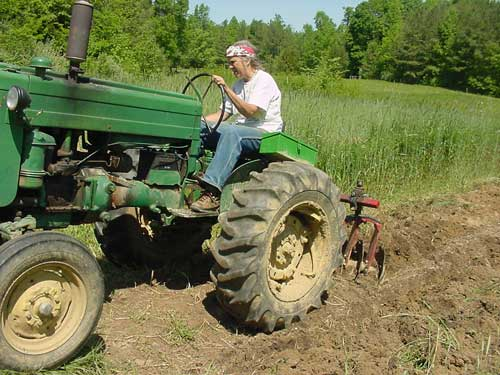 Cathy on tractor