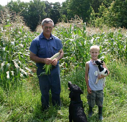 Bobby and Aaron in front of corn