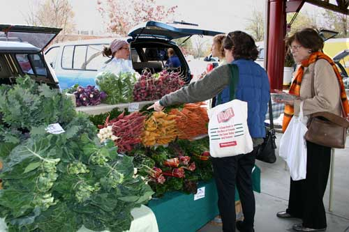 Customers check out the Castlemaine produce