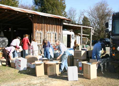 unloading boxed potatoes
