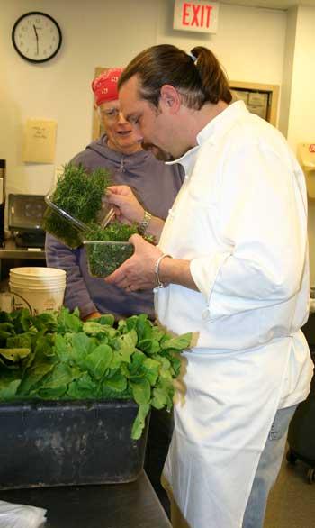 Chef Sam Poley checks out the fresh herbs at Starlu