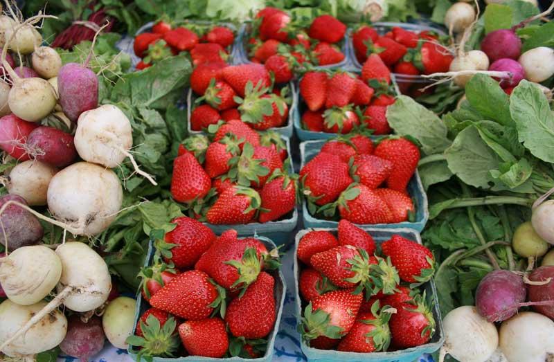 fresh strawberries and radishes