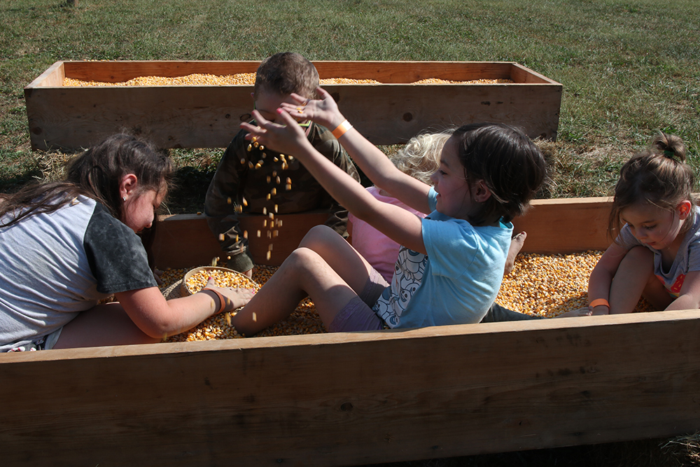The kids were having a great time playing in the corn bin.
