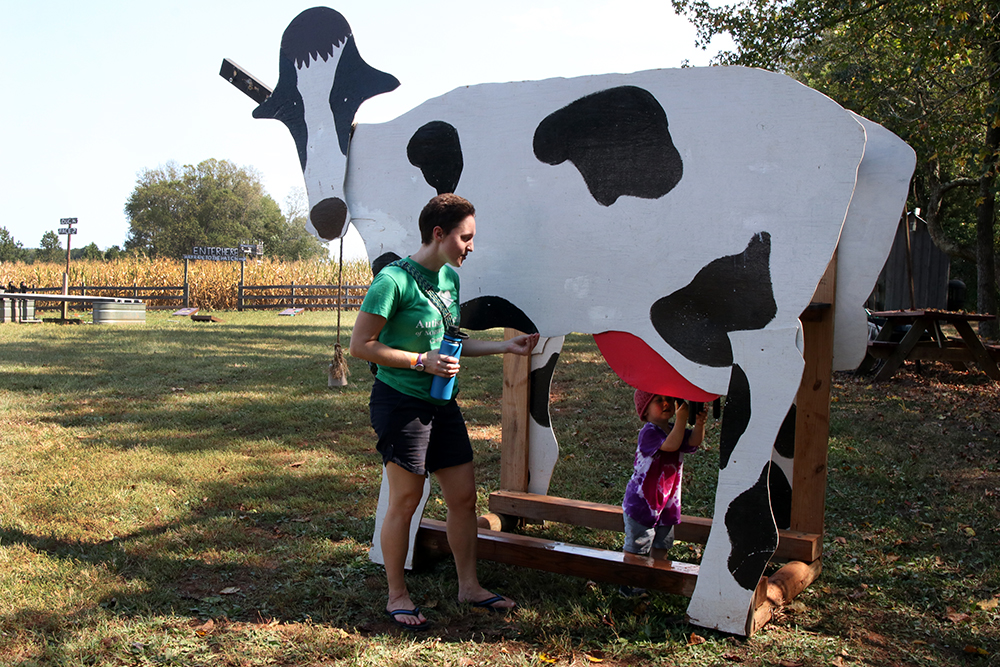 This milking cow greets visitors at the farm entrance.