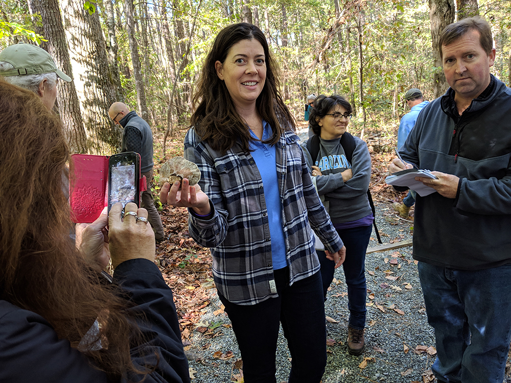 Susannah Goldston helps identify mushrooms on the walk.