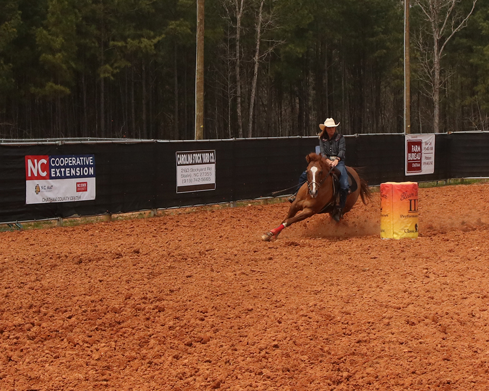 Kaci Isley demonstrates barrel racing.