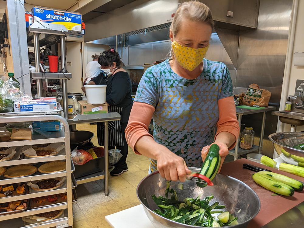 Moya Hallstein peels cucumbers