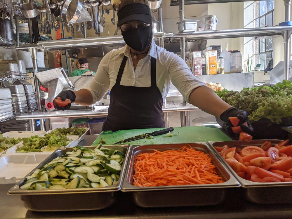 Zulema prepares salads