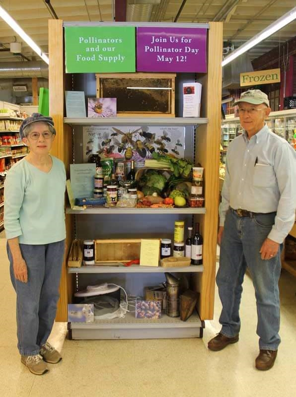 Judy and Jim Pick at a Pollinator Day display in Chatham Marketplace