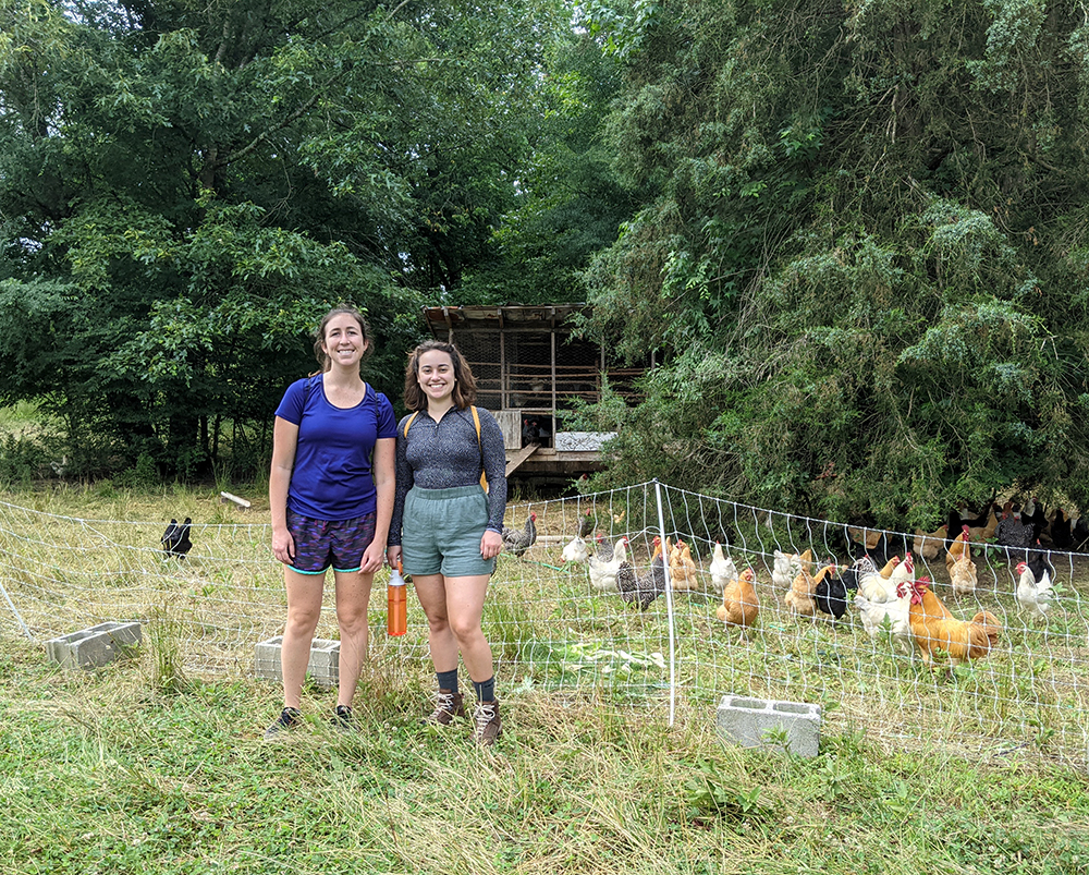 Two women with chickens