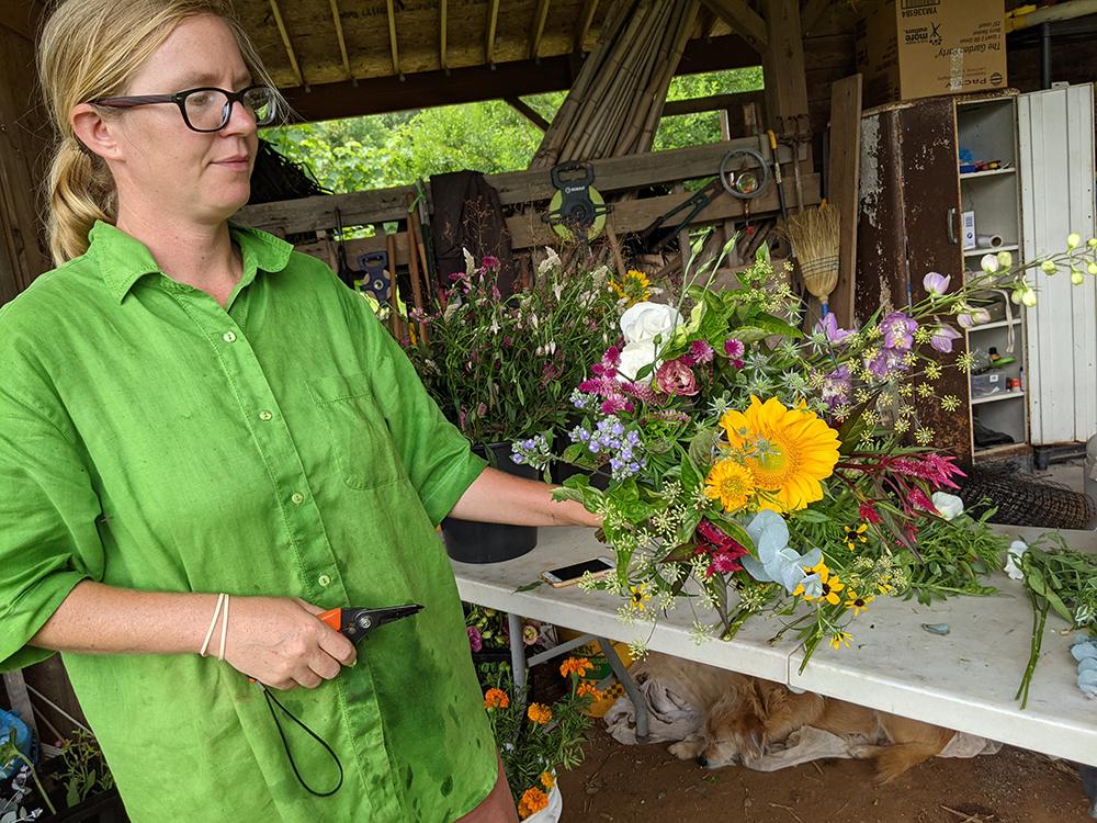 Woman showing flower bouquet